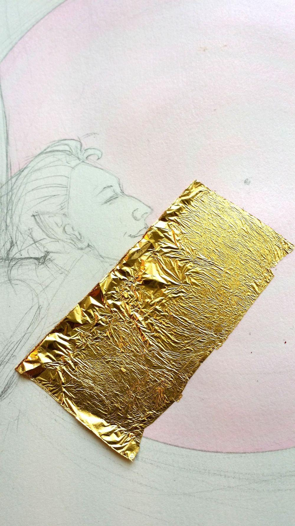 gold leaf application on rock